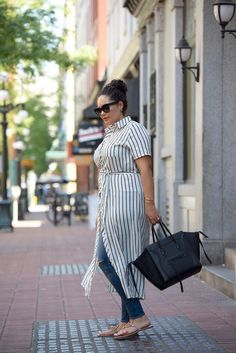 Tanesha Awasthi (formerly known as Girl with Curves) wearing a stripe shirtdress, skinny jeans and Celine Phantom in downtown Vancouver.
