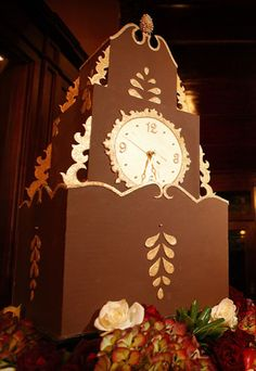 Grandfather Clock - What to do when a cake lady weds on New Year's Eve?  Build a cake that can actually tell you when it's midnight.  We made Erin's cake with chocolate fondant panels and 23 karat edible gold trim.  Behind its frosting clock face, a battery pack allowed the clock to tick away the evening.  Luckily, the talented Marc and Leda from Studio 306 were there to take these amazing photographs, because the cake ladies were bu