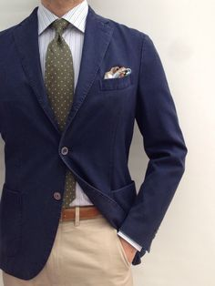 Navy sport coat, white shirt with light blue and brown stripes, olive tie, khakis
