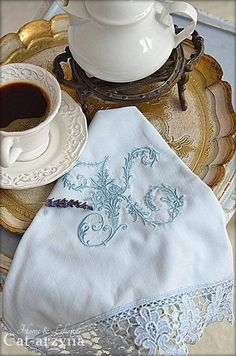 Tea ~ I attended a tea party many years where the hostess had embroidered personalized initialed napkins for each of her guests like this. I thought it was an extremely thoughtful gift. Made by hand, inexpensive, but very time consuming. Which made it more precious.