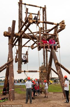 Look what we built: Scouts from around the world sit on an impressive gateway they built during the World Scout Jamboree in Sweden this year