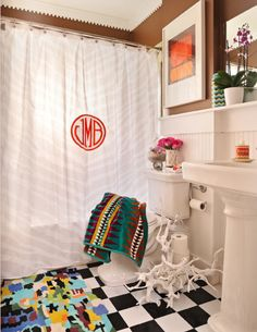 gorgeous bathroom - love the crisp white with the mix of patterns and colors (Guest bath at Rice)