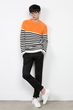 Stripe and color block sweater. Black dress pants. White sneakers.