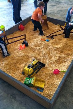 This is such a great idea! Instead of using sand in a sandbox, you can use corn kernels. It's less of a mess and still as much fun for kids.