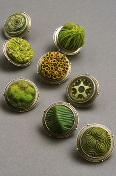 Polymer clay brooches made from polymer clay, each one a different. By Cynthia Toops.
