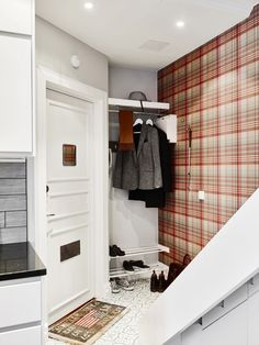 Plaid wallpaper in entryway of home