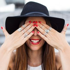 Italian blogger Irene Colzi looking cool and stylish with red lips, red nails and lots of sterling silver rings from PANDORA. #PANDORAstyle #PANDORAring