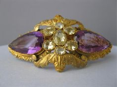 A 14k gold, yellow crystal beryl, and amethyst bracelet from the Victorian era.