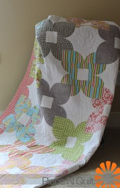 """Piece N Quilt  use all-over designed fabrics--don't like the stripes or dots--the """"flower"""" shape gets chopped up"""
