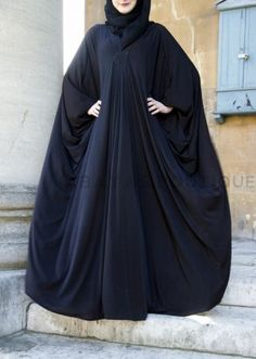 Black Beauty Jersey Abaya Black Beauty has all the charm and modesty. Perfect for plus size and maternity wear. It has a striking star shape sequin detail below the v shape neckline. The Abaya is a freesize and has large butterfly sleeves and is made of Hijab Fashion 2016, Modern Hijab Fashion, Arab Fashion, Islamic Fashion, Muslim Fashion, Abaya Designs, Abaya Style, Hijab Dress, Hijab Outfit