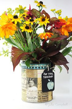 What a simple idea! Use gel adhesive to put pictures of the happy couple and quotes on tin cans. A personalized centerpiece.