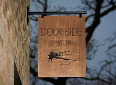 Expanded an identity of a restaurant based upon hand drawn fishing hooks and fishing flies.
