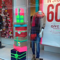 Gap holiday window display- I had already bought yarn to use in place of ribbon but this solidified my gift wrap plan this year.