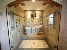 A Freestanding Americh Soaker Tub Surrounded By Recycled Granite Is The Focal Point In This Once
