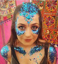Blue face and body festival glitter