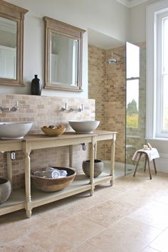 The bathroom was always going to be a winner....it's on the very large side! They reused the Upton console table from OKA to hold the basins.. Walls in Fired Earth Flake Grey Paint. Modern Country Style: Kate's Creative Space Full Home Tour Click through for details.