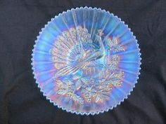 """Lot # : 435 - 9"""" N Peacocks Plate w/ Ribbed Ext. – Ice Blue"""