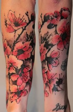 Unique cherry blossom tattoo..almost like watercolor ink. I am stuck on this down my arm :) I think I like this better than the traditional cherry blossoms too