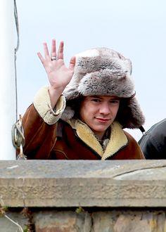 Fluffy boy in a fluffy hat