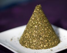 Za'atar Spice mix     1/4 cup sesame seeds (toasted)  2 tbs dried thyme  2 tbs dried oregano  1 tbs sumac (or a bit more)  1 tbs geera (cumin, optional, depends on taste)  1 teaspoon of salt to taste.    Great mixed with oil, brushed onto hot bread or baked with it in the oven.
