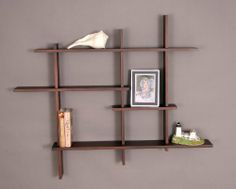 "Wall Shelf - Deluxe Four Level - Mahogany Finish (Mahogany) (40.75"" H x 48.75"" W x 6"" D) by Woodform. $119.00. Color: Mahogany. Space-Saving Display. Contemporary Design. Size: 40.75"" H x 48.75"" W x 6"" D. Hardwood Construction. Make a bold statement in your home with this deluxe mahogany finished 4-level floating wall shelf! Constructed of sturdy northern hardwoods, this display shelf offers simplistic design while providing a space-saving solution for collectible and photo disp..."