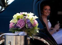 Bride's bouquet with bride in background