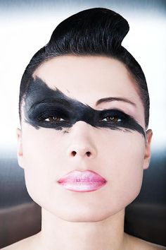 Simple, natural face make-up with one dramatic feature. Reminiscent of Leigh Bowery (paint dripping down upper face)