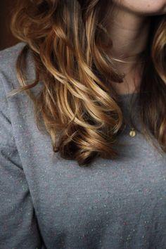 Medium length hair cut on wavy hair (would be cute with bangs!)