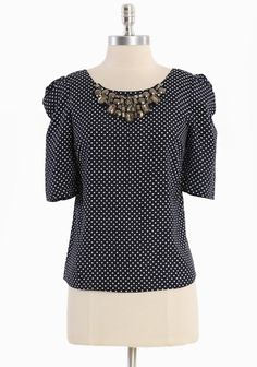 "Eastside Manor Jeweled Blouse 38.99 at shopruche.com. We adore this chic allure of this silky navy blue blouse with a white print and statement jeweled neckline. Lightweight.  100% Polyester, Imported, 23"" length from top of shoulder"