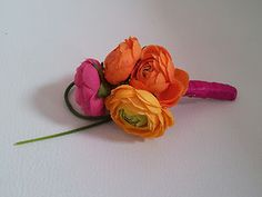 Bright wedding buttonhole for the boys.