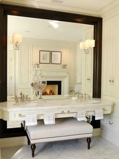 Calacatta Gold marble countertop.  Love the full mirror.
