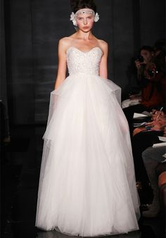 4620 by Reem Acra    Silhouette: A-Line  Neckline: Strapless, Sweetheart  Waist: Natural  Gown Length: Floor  Train Length: None  Fabric: Tulle  Embellishments: Beading  Color: Ivory, Peach  Size: 0 - 20