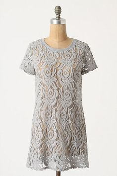 This Anthropologie top has inspired me to attempt something similar with a bolt of black lace I've been hoarding for a few years. Maybe sleeveless though?