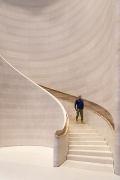This Apple Store in Singapore features a hand-carved, curved stone staircase with built-in handrails. #Staircase #Stone