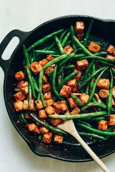 Easy, 9-ingredient tofu stir-fry with baked tofu marinated in an almond-tamari sauce. Serve with veggies and rice for a flavorful, plant-based meal!