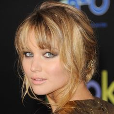 Jennifer Lawrence's (Hunger Games) honey blonde hair colour compliments her skin tone and makes her eyes pop (with help from some great eye makeup).  Beautiful.