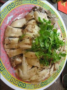 white cut chicken platter. i want half with skin on, half without maybe... also served separate from the rice with cilantro garnish. need to find some way to make the chicken look appealing.