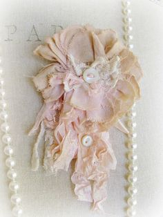 Torn Pink Fabric with bits of lace and old buttons...  what a mess... not sure why I like it, but I definitely do.