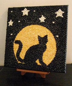 Halloween Black Cat and Moon Mosaic Bean Art This black cat is showing off i. Mosaic Crafts, Mosaic Projects, Mosaic Art, Projects For Kids, Art Projects, Coffee Bean Art, Seed Craft, Seed Bead Art, Button Art