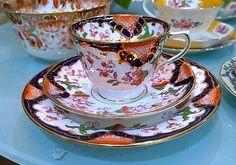 Royal Stafford bone china Imari pattern trio tea set C 1950s ironstone red emerald green and cobalt blue and gilded pattern.