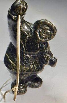 A personal favorite from my Etsy shop https://www.etsy.com/ca/listing/467493475/inuit-eskimo-art-sculpture-of-a-hunter