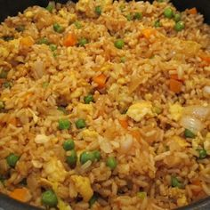 "FRIED RICE ""My Style"", 3 cups cooked white rice (day old or leftover rice works best!), 3Tbs sesame oil, 1C frozen peas & carrots (thawed), 1 small onion, chopped; 2tsp minced garlic, 2eggs, slightly beaten; 1/4C Soy Sauce."