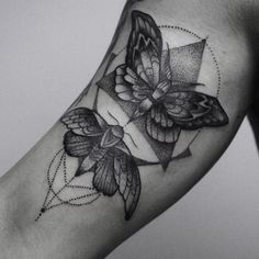 butterflys and geometric tattoo on the arm