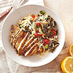 This Greek-flavored chicken dinner is a touch over 400 calories, but it includes your veggies and pasta -- making it a complete dinner. Lemon peel and juice punch up flavor without adding sodium or fat. Try out our Greek Oregano Chicken with Spinach, Orzo, and Grape Tomoatoes for your next dinner party.