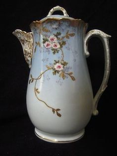 Hand painted 9 Tall oval bodied chocolate (Coffee or tea) porcelain pot imported from Limoges, France by L. (Lewis/Lazarus) Strauss & Son's circa main body of the pot is sky blue w Tea Pot Set, Pot Sets, Chocolate Pots, Chocolate Coffee, Antique Dishes, China Sets, Old Houses, Coffee Time, Tea Time
