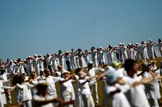Members of the White Brotherhood perform a ritual dance near Babreka Lake on August 19, 2011, as part of a celebration of their New Year. The movement, whose founder is Bulgarian Peter Danov, is a synthesis of Christianity and Hinduism. (Stoyan Nenov/Reuters)