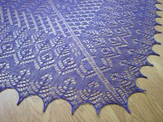 I had a crazy idea to knit all the shawls in purple lace this summer. But the cobweb made this one a bit of a marathon and it may be a while before I start another shawl.  Who am I kidding?