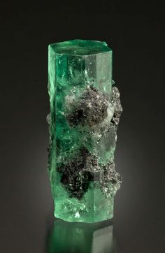 Emerald with Calcite and Pyrite inclusions from Chivor Mine, Colombia