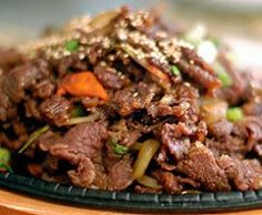 BUL-GO-GI  Grilled Marinated Beef  1 lb thinly sliced beef (sirloin or rib eye)  5 tbsp sugar  ½ cup soy sauce  2 buds finely chopped garlic (can be crushed but remove buds before serving)  ¼ tsp salt  5 tbsp Mirin (sweet sake, optional)  2 tbsp sesame oil  2 tbsp toasted sesame seeds  1 cup split green onions  2 cups thinly sliced carrots (optional)