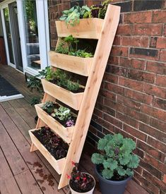 Create a magical patio space with a vertical cedar ladder planter. The vertical set-up is a space saving way to grow a wall of cascading flowers or strawberries, vegetables or herbs, especially if you have limited outdoor space or live in an apartment. Garden Ladder, Herb Garden Pallet, Diy Herb Garden, Plant Ladder, Cedar Garden, Patio Planters, Herb Planters, Deck Planter Boxes, Vegetable Planter Boxes